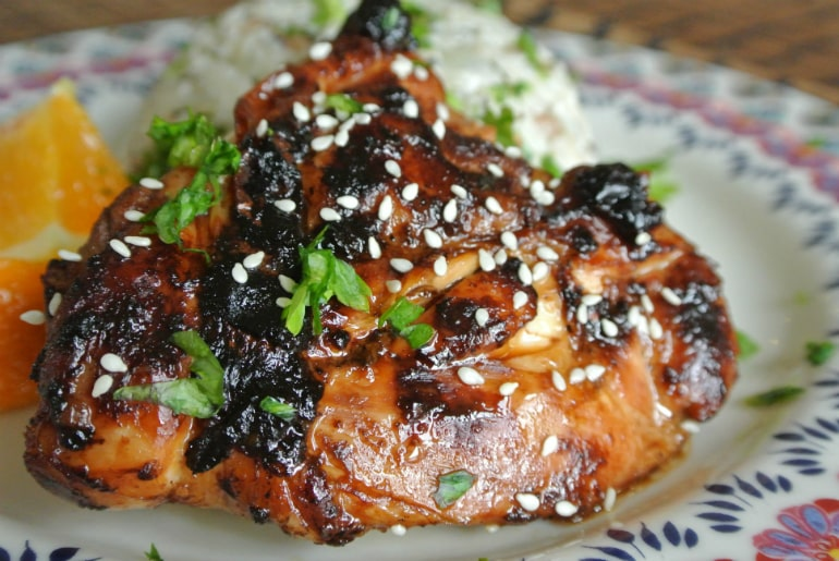 Sticky ginger chicken recipe with coconut rice sesame seed garnish