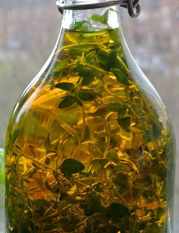 Garlic thyme flavoured rapeseed oil close up